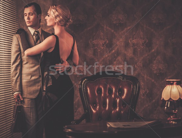 Couple in retro interior near a window Stock photo © Nejron