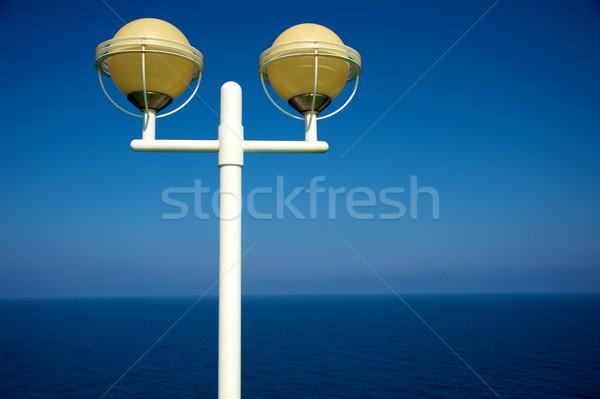 Streetlight against sea view Stock photo © Nejron