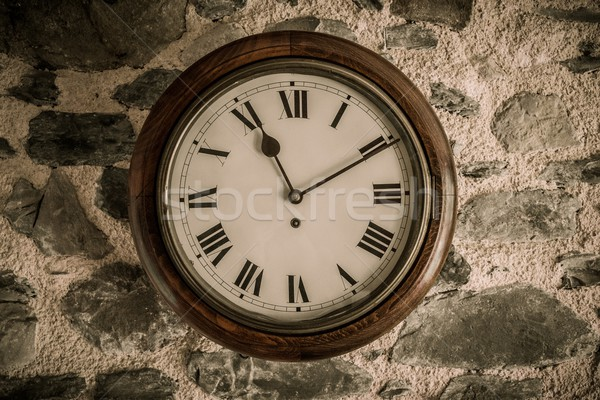 Vintage wooden wall clock on stone wall Stock photo © Nejron