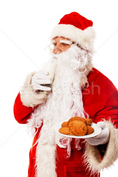 Santa Claus with oatmeal cookies and glass of milk isolated on white background Stock photo © Nejron