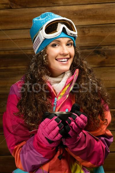 Heureux femme ski vêtements tasse boisson chaude Photo stock © Nejron
