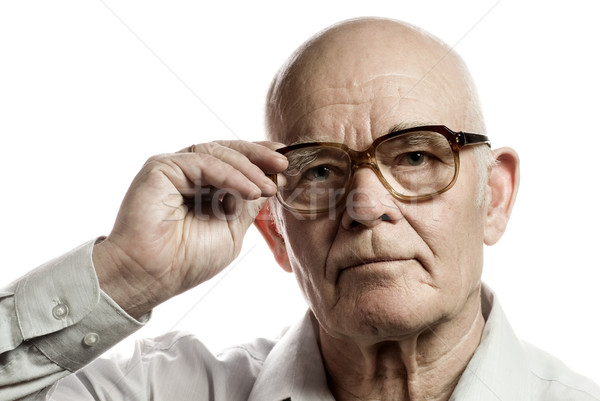 Elderly man with massive glasses isolated on white background Stock photo © Nejron