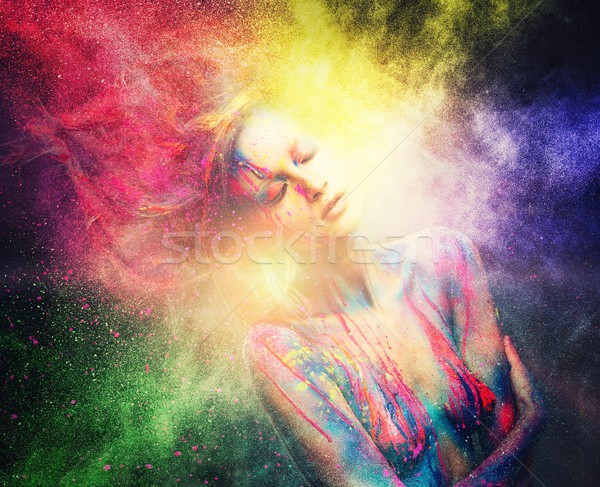 Stock photo: Woman muse with creative body art and hairdo in colourful powder explosion