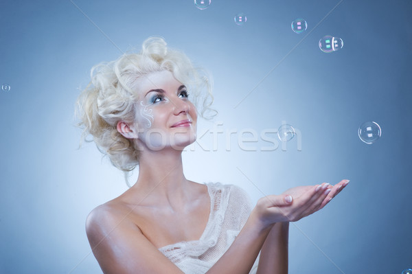 Beautiful snow queen with a foam bubbles 