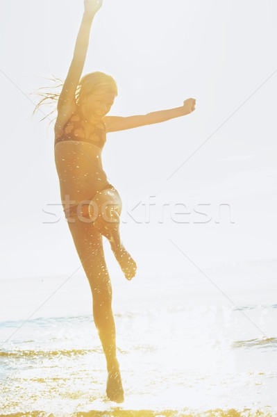 Happy girl running in the sea Stock photo © Nejron