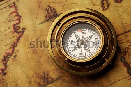 Vintage compass on the old map Stock photo © Nejron