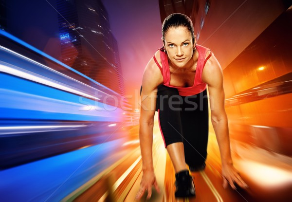 Athletica woman against night city. Stock photo © Nejron
