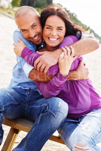 счастливым улыбаясь пару пляж женщину Сток-фото © Nejron