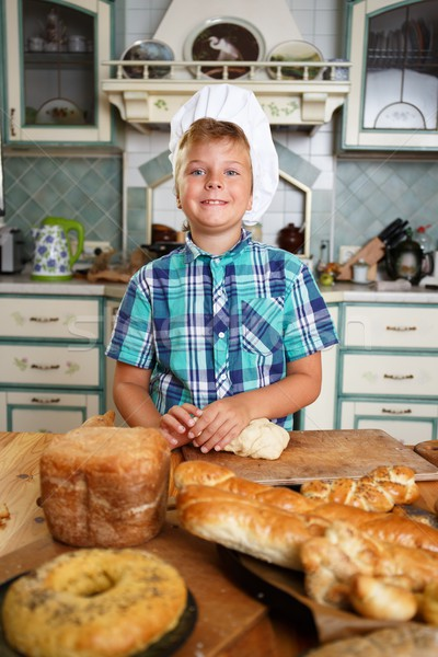 Young cook boy making homemade pastry Stock photo © Nejron