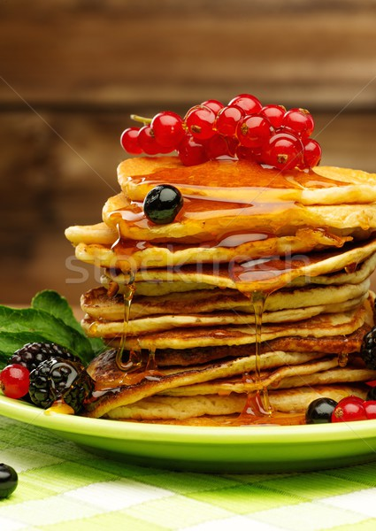 Tasty pancakes with maple syrup and fresh berries on a plate  Stock photo © Nejron