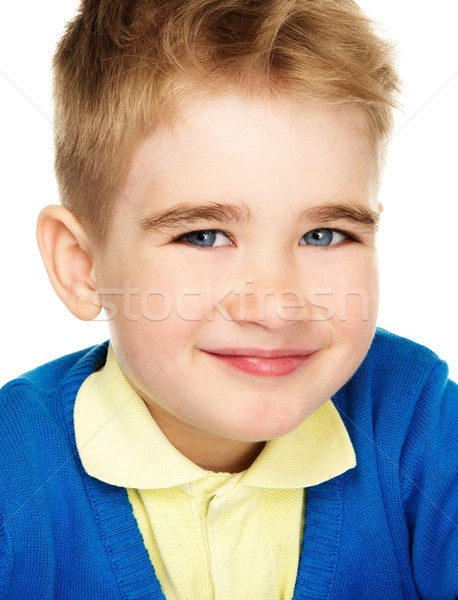 Sly little boy in blue cardigan and yellow shirt  Stock photo © Nejron