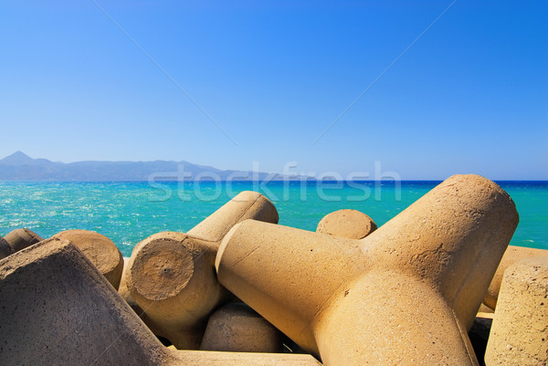 Stock photo: Seashore with concrete breakwater cones