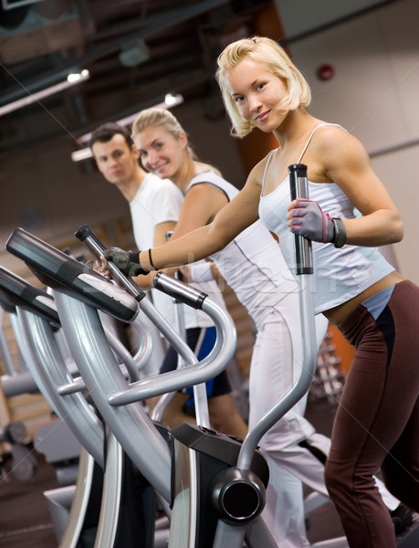 Group of people jogging in a gym Stock photo © Nejron