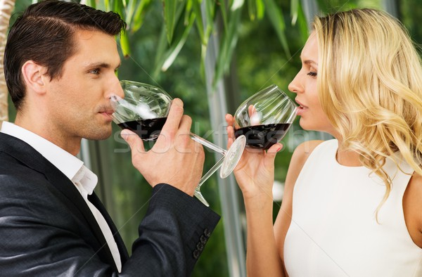 Couple with glasses of red wine in restaurant Stock photo © Nejron