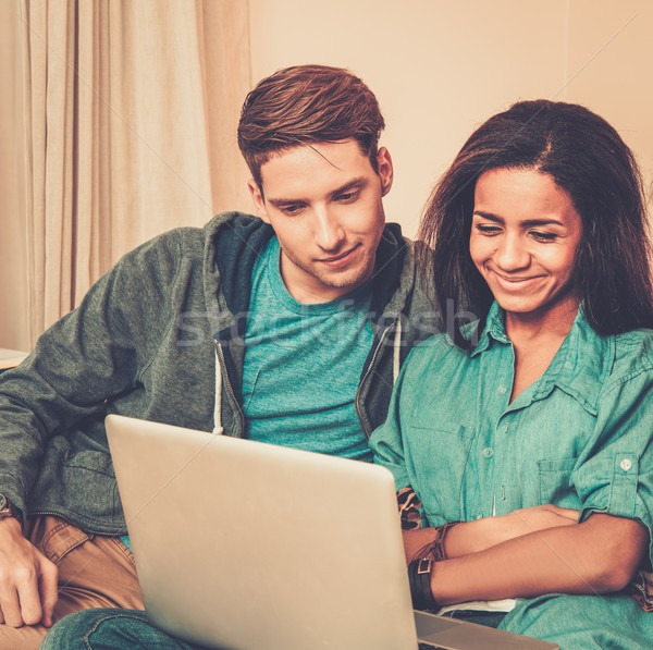 Young multi ethnic students couple preparing for exams in home interior  Stock photo © Nejron