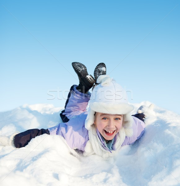 Little girl sliding in the snow Stock photo © Nejron