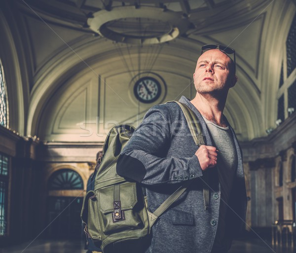 MIddle-aged tourist with backpack in the railroad station building Stock photo © Nejron
