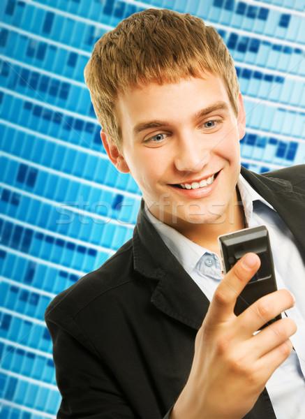 Heureux jeunes bel homme parler téléphone visage Photo stock © Nejron