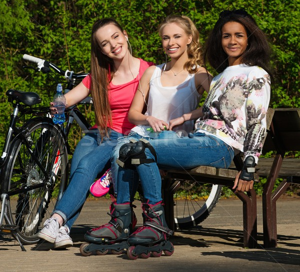 Multi ethnic group of sporty teenage girls in a park Stock photo © Nejron