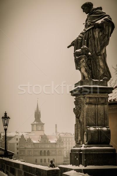 Statue on a Charles bridge in Prague Stock photo © Nejron