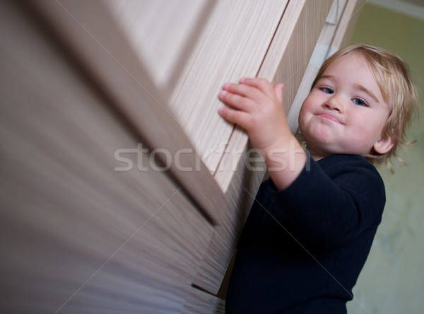 Adorable baby boy making funny face Stock photo © Nejron