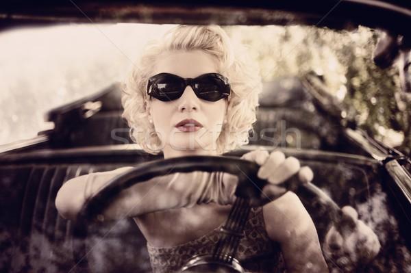Retro woman behind steering wheel Stock photo © Nejron