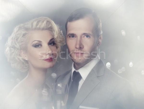 Retro couple with glasses of champagne portrait Stock photo © Nejron