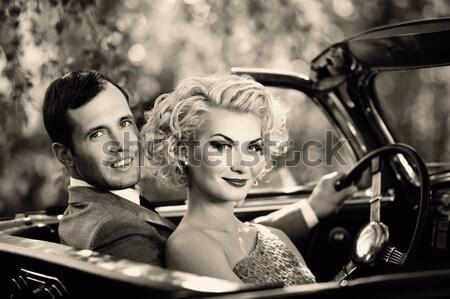 Retro couple in convertible Stock photo © Nejron