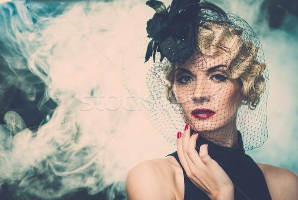 Elegant blond retro woman   wearing little hat with veil in smoke Stock photo © Nejron