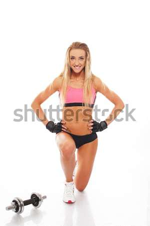 Sporty woman with dumbbell doing fitness exercise isolated on white  Stock photo © Nejron