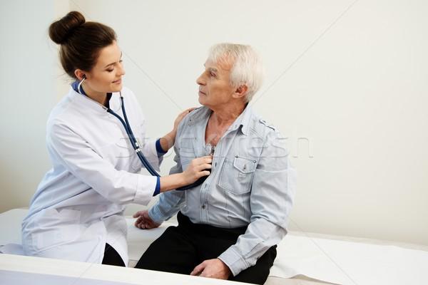 Senior man and doctor woman with stethoscope Stock photo © Nejron