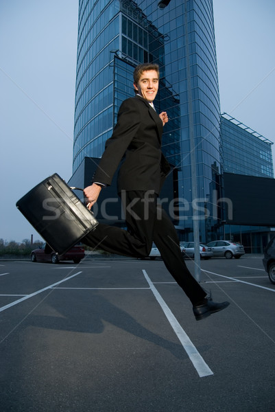 Happy business man running home after work Stock photo © Nejron