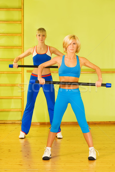 Beautiful women exercising in fitness club Stock photo © Nejron