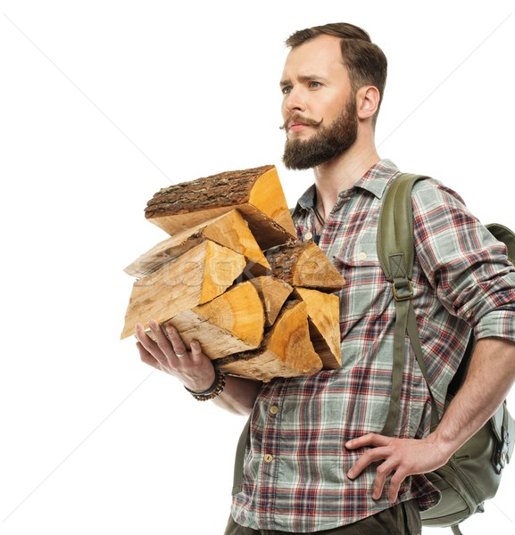 Handsome traveler with backpack and logs for bonfire  Stock photo © Nejron