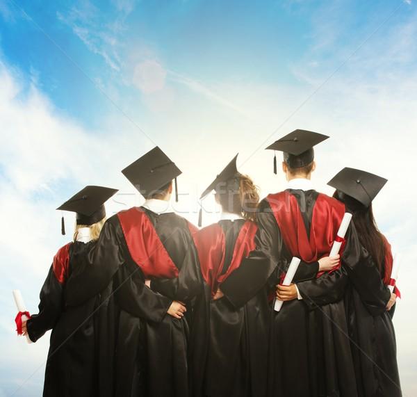 Groep jonge studenten zwarte blauwe hemel meisje Stockfoto © Nejron