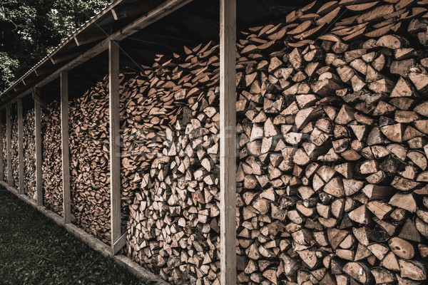 Stockpile of sawed logs under shed Stock photo © Nejron