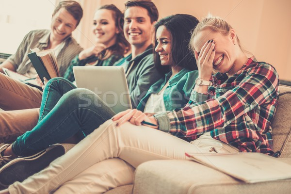 Group of multi ethnic young students preparing for exams in home interior  Stock photo © Nejron