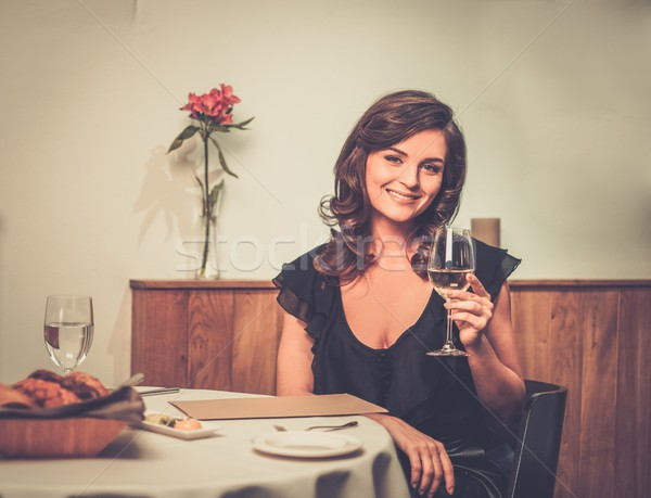 Beautiful young lady alone in restaurant  Stock photo © Nejron