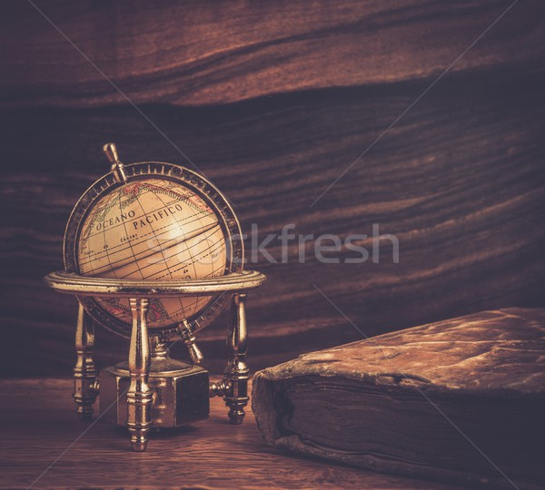 Vintage book and little globe on a wooden background  Stock photo © Nejron