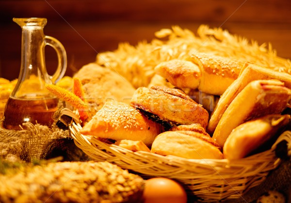 Basket with homemade baked goods on a table Stock photo © Nejron