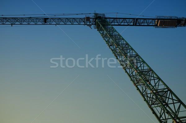 Hoisting crane against evening sky Stock photo © Nejron
