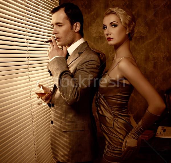 Retro couple near a window Stock photo © Nejron