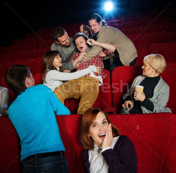 Fight between young men happening in cinema during film show Stock photo © Nejron