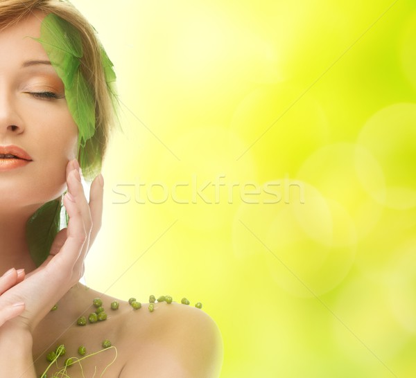Dreaming young woman in conceptual spring costume  Stock photo © Nejron