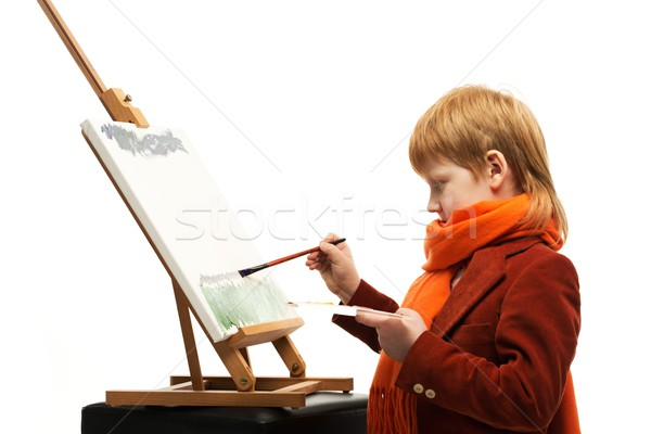 Little redhead boy drawing picture on an easel Stock photo © Nejron