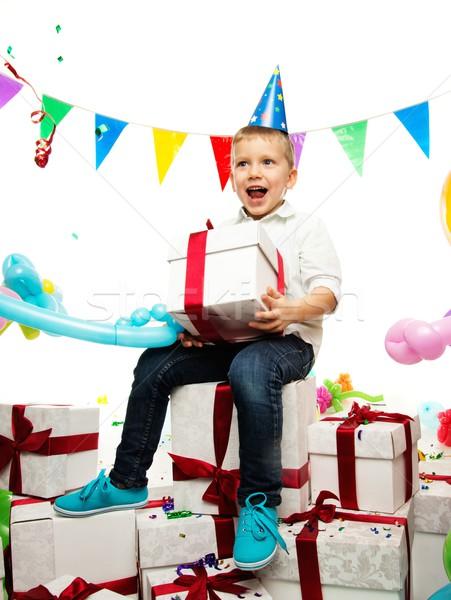 Little happy boy holding gift box Stock photo © Nejron