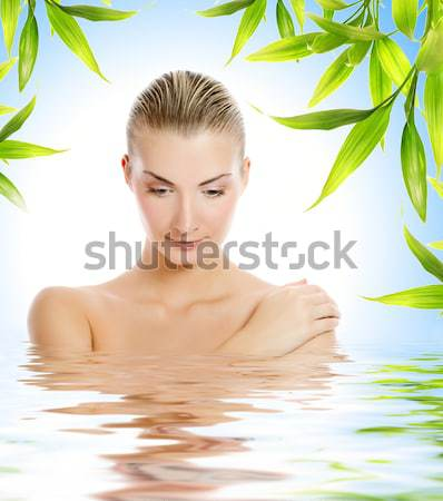 Beautiful young woman with aroma bath ball reflected in rendered Stock photo © Nejron