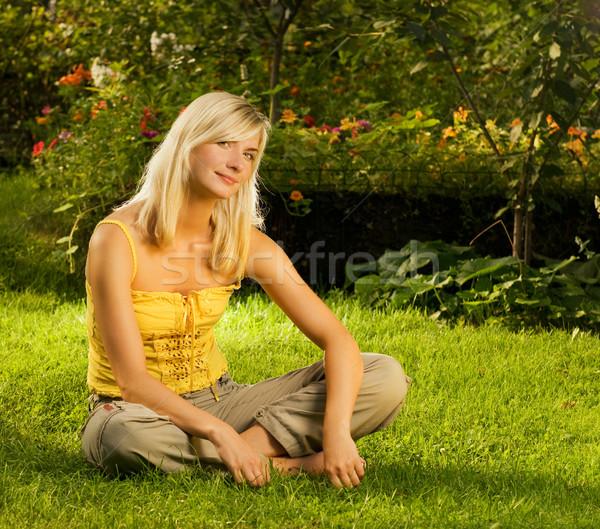 Beautiful Young Woman Relaxing Outdoors Stock Photo