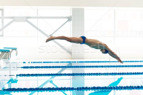 小さな 筋肉の スイマー ジャンプ スイミングプール 男 ストックフォト © Nejron