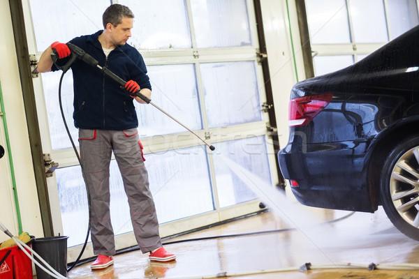 Férfi munkás mosás luxus autó lomtár Stock fotó © Nejron